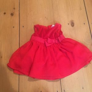 Baby girls red dress with velvet top and bow.